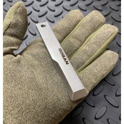 Rogan RPT stainless steel  held in a hand